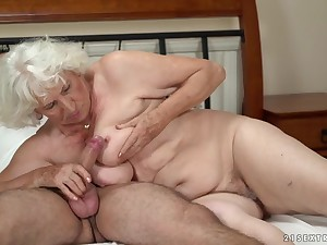 Horny granny gets the brush pussy serviced by a young guy