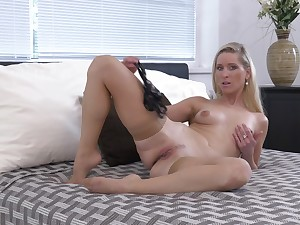 Sexy solo mature Uma Zex in stockings plays with her wet pussy