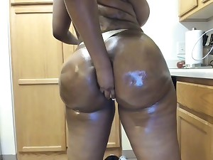 Ebony Zmeena Orr sticks banana in butt - oiled surrounding fat refill kitchen amulet
