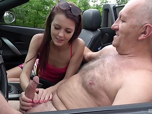 Mechanical girl sucks her ancient man in the passenger car until he comes on her face