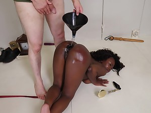 Ebony slave girl Noemie Bilas enjoys getting tortured wide of her polished
