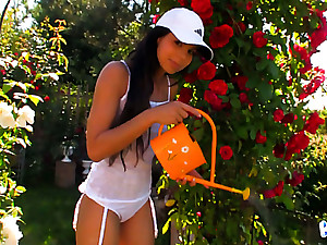 Romantic slender tanned hottie Kiki pleases her pussy in the rose garden