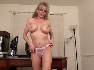Busty blonde MILF secretary Jill E. strips at get under one's office