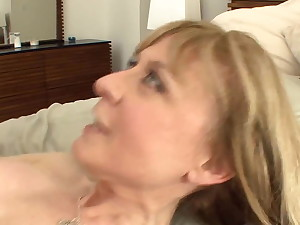 Busty cougar seduces in stockings and a colours